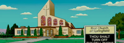 A picture of Springfield church from the Simpsons cartoon with a wayside pulpit stating 'Thou Shalt Turn Off Thy Cell Phone'