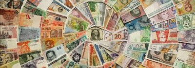 A selection of banknotes from different countries arranged in concentric circles.