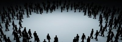 Numerous small silhouette figures converging on the centre of an empty circle.